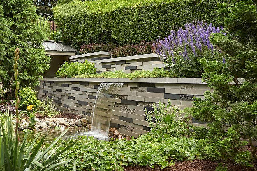 Garden waterfall built with our Graphix retaining wall.